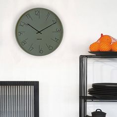 The Karlsson Elegant wall clock is both sophisticated and funky and comes in white and green. Make a statement in any room of the house with this designer European clock. Tall Cabinet Storage, Numbers, Shelves, Elegant, Interior, Wall, House, Furniture, Design
