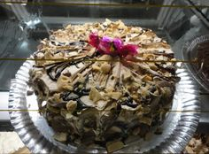 Chocolate Brownie Cake    When you are feeling in need of something a little more sophisticated , try our new style almond chocolate fudge brownie cake for an elegant creamy cake to get your taste buds in a whirl.