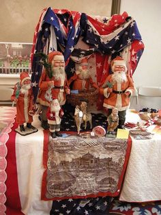 Patriotic display of Santas from The Golden Glow of Christmas Past