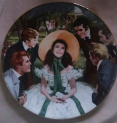 """GONE WITH THE WINDcollector plate  """"Scarlett and Her Suitors"""" by Howard Rogers  1stplate intheGoneWith the Wind: Golden Anniversaryseries  Issued byW.S. George(The Bradford Exchange) in 1988  Bradex # 84-G20-1.1  This was the first plate and the firstseries of plates issued by W.S. George.  8 1/2"""" plate"""