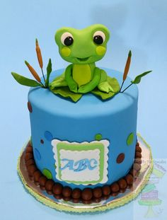 Froggy Frog Baby Shower Cake Frog theme shower cake! Frog and decorations are gum paste. Cake is covered with mmf.