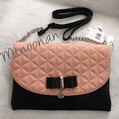 "NWT Jessica Simpson Hailey Color Block Purse NEW WITH TAGS Jessica Simpson Hailey Purse. Can be worn on the shoulder, as a crossbody or remove the strap and carry as a clutch!  • Dimensions: 11""W x 7""H x 2""D with 58"" adjustable/removable strap • Color: Salmon Pink / Black • Interior: Divided in two sections with large zipper compartment in the center. Has a side wall zipper pocket, 6 card slots & 2 slip pockets  • Front snap closure • Silver tone hardware • Animal print lining    I have more…"