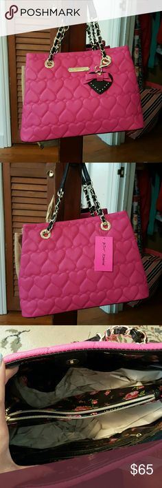 Betsy Johnson Pink Handbag!! Nice bright pink color bound to get anyone's attention, quilted with hearts on the outside!! Has a floral interior with 4 interior pockets. Its a handbag that has a button to close rather than a zipper. Brand new. Betsey Johnson Bags Shoulder Bags