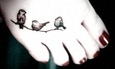http://tattoomagz.com/birds-tattoos-2/red-nails-and-black-bird-tattoo/