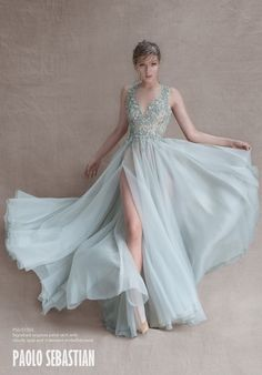 Stunning powder blue wedding dress by Paolo Sebastian. We love the gorgeous embellished illusion neckline   http://www.weddingpartyapp.com/blog/2014/10/29/paolo-sebastian-wedding-dresses-whimsical/
