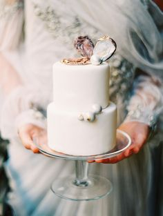 Elegant oyster shell cake toppers: http://www.stylemepretty.com/2016/02/05/luxurious-parisian-wedding-inspiration/ | Photography: Katie Stoops - http://katiestoops.com/