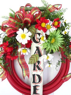 RED GARDEN HOSE Wreath- Spring Summer Wood Garden Sign Faucet Bucket Free Shipping. $90.00, via Etsy.
