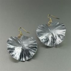 """Shimmer and shine in head-turning style with these 2"""" #Aluminum Lily Pad #earrings. Meticulously crafted with a mesmerizing mix of texture and light that captures the season's most-wanted look in jewelry. #handmadejewelry #handmade #jewelry $65"""