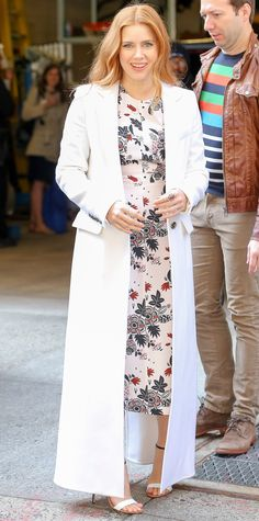 Amy Adams in a floral dress and white duster coat