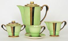 Carlton Ware - A 1930's Art Deco part coffee service comprising coffee pot, milk jug, sucrier and one cup and saucer each with black and gilt banding and edges against a green ground, printed marks
