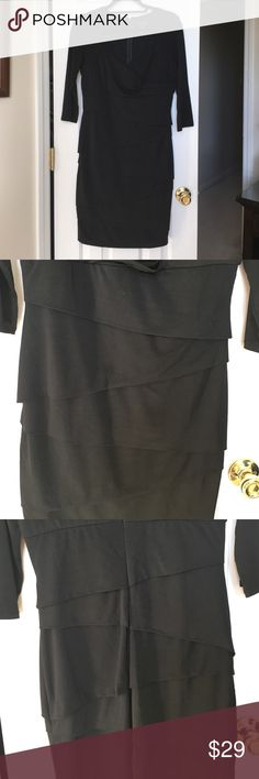 "WHBM Slimming dress. Classy black slimming dress. Has built in shape wear to smooth your silhouette. Layered panels on front and back add additional slimming effect. 18"" zipper in back. Measures 36 inches from neck line to hemline in back. Perfect for evening but simple enough for office.  Worn once. Like new. White House Black Market Dresses"