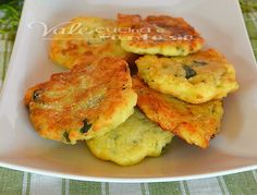 Frittelle di zucchine con patate e parmigiano. My mom made up potato 'pancakes' as a child, but I never thought of adding zucchini.