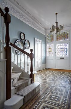 hallway flooring Stunning light filled Edwardian hallway with original floor tiles. Farrow and Ball wall colour. Heathfield pendant light with cluster of circular wall mirrors.