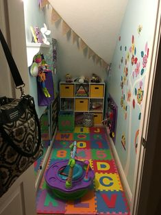 Baby playroom made from closet under stairs