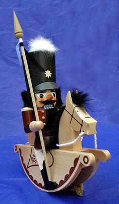 A Christian Ulbricht Nutcracker Riding Soldier handcrafted in Germany.  Nutcrackers have a romantic history. Wood turning on lathes can be traced back to the small German mining town of Seiffen, in the mountains of the Erzgebirge not far from the Czechoslovakian border. Records document the Ulbricht family as wood turners since the early 1700's. Their various nutcrackers are of the finest quality.
