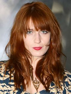 British Famous Singer Florence Welch with her Banged-Up-Fiery-Red Hairdo.