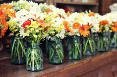 {Mason Jar Centerpieces}  Who needs vases? Simply gorgeous.