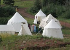 General Tent Designs.  Single pole, spoked pavilions from the same site.  http://www.housebarra.com/PastTimes/tents/designs.html