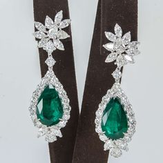 Emerald Diamond Platinum Drop Earrings | From a unique collection of vintage drop earrings at https://www.1stdibs.com/jewelry/earrings/drop-earrings/