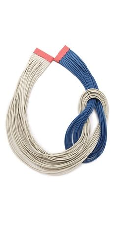 This handmade necklace features twisted waxed cords. Magnetic closure at leather-bound ends.