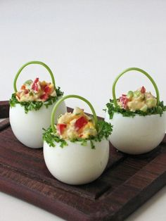 Deviled eggs stuffed with pepper, onion, radishes, chives and parsley