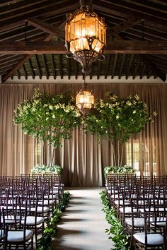 Wedding ceremony in The Spanish Lounge at the Cloister at Sea Island | @christianoth | Brides.com