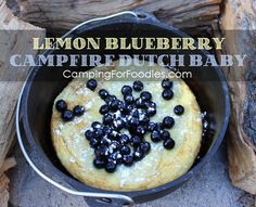 Easy Campfire Dutch Baby Recipe With Lemon-Kissed Blueberry Topping! Simple batter, fresh fruit, Dutch oven camping recipe for breakfast or dessert! http://www.campingforfoodies.com/lemon-blueberry-campfire-dutch-baby/