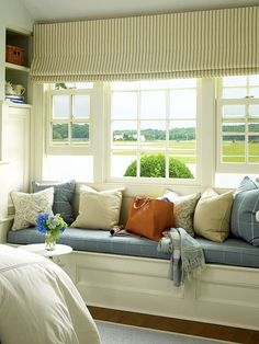 This window seat is in the same room as one of the other photos. Colors, light, joy...loverly!