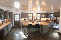 fieldstone floor  eclectic kitchen by Kitchens By Design