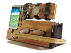 "Super cool accessory caddy; love the design. (There's a cup for keys coins on the back.) ""Watch and Eye Dock Galaxy S4 S3"" by undulatingcontours on Etsy, $42"