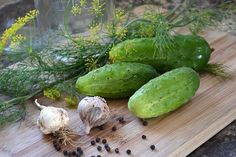 How to make homemade dill pickles using fresh cucumbers, dill, spices, and brine. This recipe follows a simple hot water bath method.