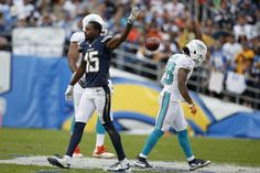 Bobby McCain Photos Photos - Dontrelle Inman #15 of the San Diego Chargers celebrates a first down reception against  Bobby McCain #28 of the Miami Dolphins at Qualcomm Stadium on December 20, 2015 in San Diego, California. - Miami Dolphins v San Diego Chargers