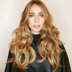 Gorgeous peach apricot golden blonde with long waves from Ruiz Salon.