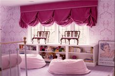 Mini Queen-Anne-style setees, over-scale damask wallpaper and a balloon valance in corduroy are all fitting nods to tradition in this playfully adult little-girl's room