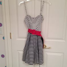 Navy & White Striped Dress with Red Belt Worn once. Ruffle detailing at top. Chevron print on top. Striped print on bottom. Cotton fabric. Removable red cotton belt. Tulle underskirt. Jodi Kristopher Dresses
