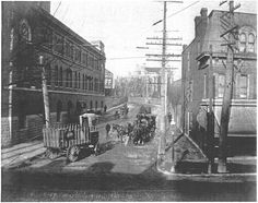 In the photo below you can see two Falstaff wagons passing each other at the intersection of Cherokee Street and South Seventh Street (now South Broadway).     The row of buildings on the right were rental properties owned by the DeMenil family. Looming in the background, where Cherokee veers to the left, is the outline of the DeMenil Mansion.