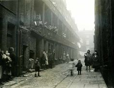 'Liverpool slums', 4 March Bishop Marshall, Daily Herald Archive, National Media Museum Collection / SSPL More On This Day photographs A photograph of people standing between two terraces in a. Liverpool England, Liverpool Home, Liverpool Street, Liverpool Docks, Old Pictures, Old Photos, Vintage Photos, Scotland History, Liverpool History