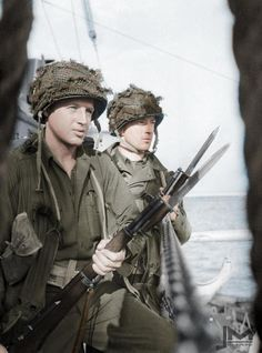 """Bayonets at the ready as the U.S. troops prepare to take their designated strips of the Normandy beach, codenamed """"Omaha"""" and """"Utah""""."""