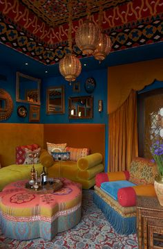 I love the bold colors. Gold is vital! It's a great accent in addition to the variety of mirrors, lanterns and printed fabrics. I also love the tray and hookah. Both are on my to buy list.