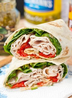This Spinach, Roasted Red Pepper, and Feta Turkey Wrap will brighten up your lunch box routine!