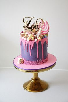 Pink and purple lolly cake with dripped ganache https://www.facebook.com/cakecarrousel