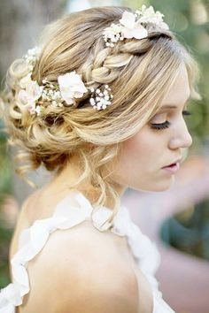 Like the brain with flowers intertwined instead of crown. or just braids on side to keep whisps away and crown.