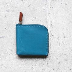 0c4975ae8391f Turquoise vegetable cow hide leather coin zip wallet
