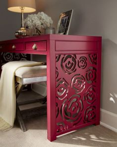 """""""Janette"""" Rose Console by Red Egg at Horchow. Pierced rose design on the sides and bold magenta color enhance its impact."""