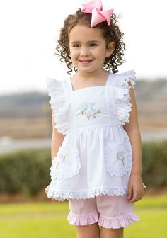Our vintage inspired Chicadee Set is hand embroidered perfection! Light weight fabric adorned with eyelet trim-ideal for all Spring and Summer! 6m-3t: bloomers, 4t-7: shorts. Try pairing this top over our Aqua Ella Dress for the cutest outfit around! Poly-cotton blend, see size guide.