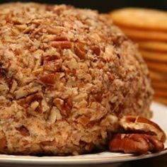 Easy Cheese Ball, I make these every year! 2 packages of cream cheese softened, 2-1/2 cups Sharp Cheddar Cheese, 1 package ranch dressing mix, 1-1/2 cups chopped pecans ( make two smaller cheese balls out of the mixture) super fun gift to give with a small box of crackers.  (I give them to coworkers and the rave about this every year)