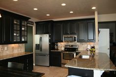 Refinished black cabinets. Color Sherwin Williams Tricorn Black.