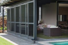 Security Shutters designed for beauty. Built for Security. AMERICAN shutters ® Security Shutters offer quality, style and added security for your home and family. American Shutters, California Shutters, Burglar Bars, Security Shutters, Shutter Doors, Industrial, Iron Doors, Blinds, Photo Galleries
