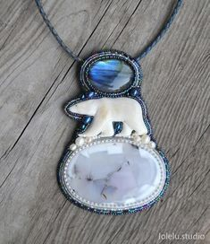 Up for sale is this beautiful bead embroidered necklace. Lonely polar bear walks on the frozen ocean under the bright dancing northern lights. Polar bear is a hand carved bone figurine. Sea of ice is a dendritic opal cabochon. Multi-fire flashing labradorite cabochon looks just like the