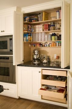 While the use of space is more practical for a serious baker, wouldn't a kitchen baking station be fabulous? Everything that you need, right there and handy. Love this! #DesignIdea #DreamKitchen